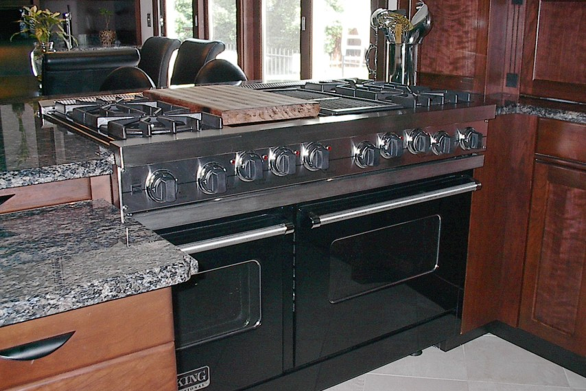 kitchen remodel, stainless steel appliances, stained cabinets