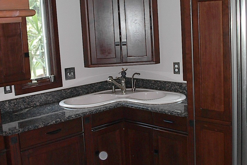 kitchen remodel, stainless steel appliances, stained cabinets, corner sink